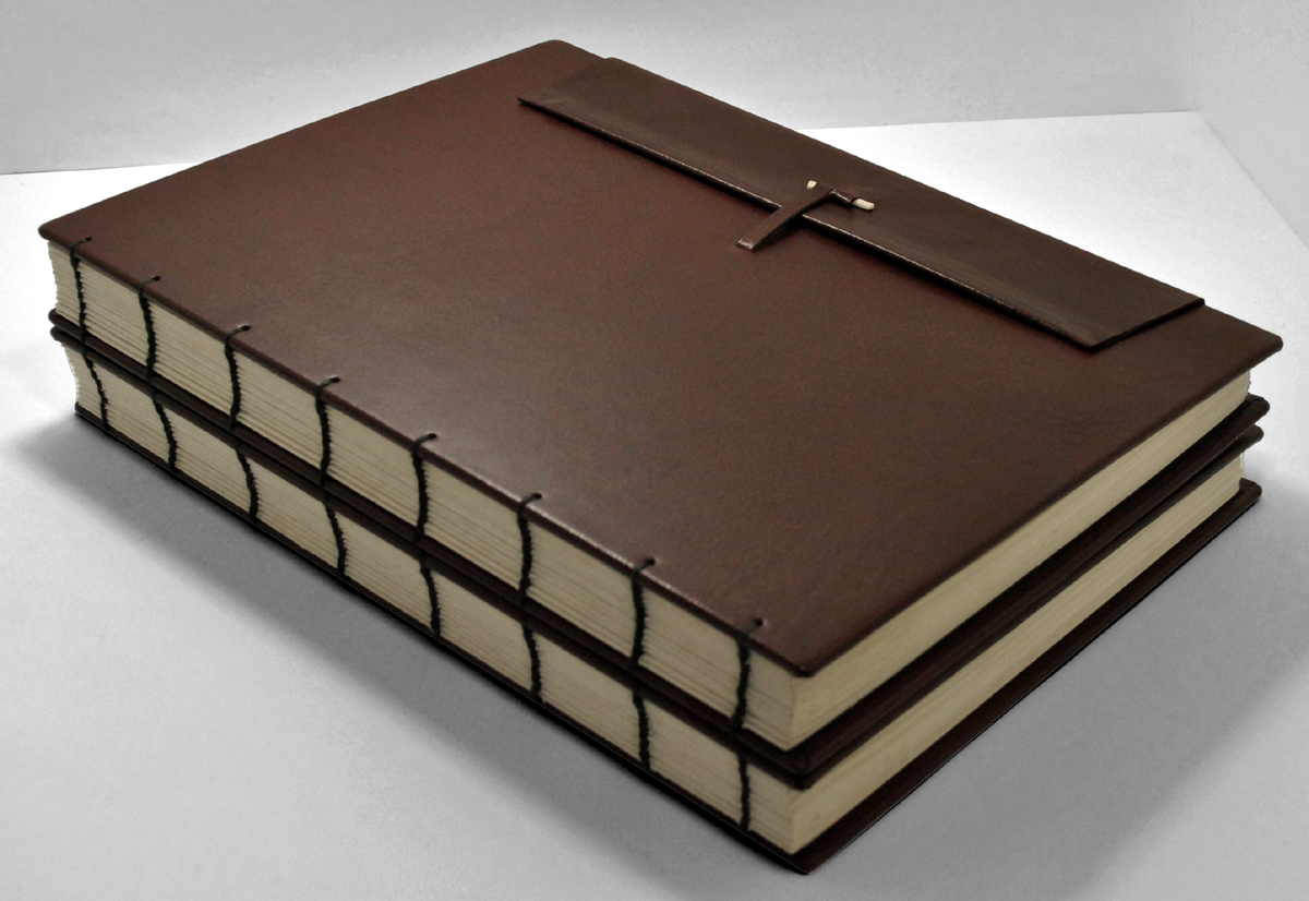 Bespoke Books, hand bound, repairs, rebinding, leather binding