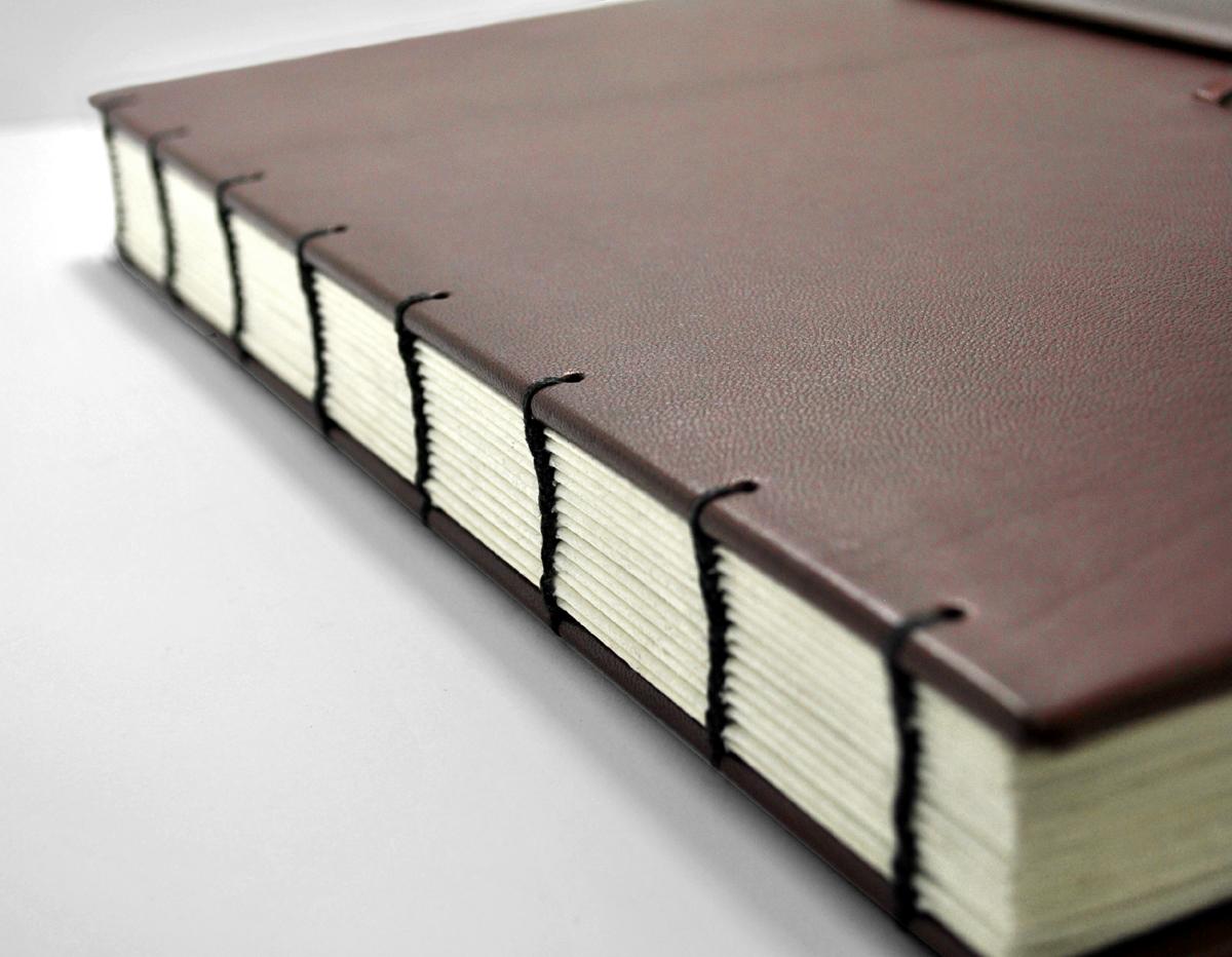 Bespoke Books, hand bound, repairs, rebinding, leather binding